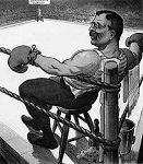 Cartoon drawing of Theodore Roosevelt as a boxer. He sits on a stool in the corner of a boxing ring with his arms leisurely resting on the top ropes. He is the only figure in the ring.