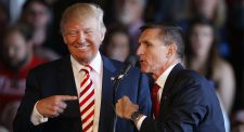 Photo of Donald Trump on the left, pointing a finger with his right hand at Michael Flynn while Michael Flynn appears to be speaking into a microphone.